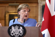 German Chancellor Angela Merkel, takes part in a press conference with Britain's Prime Minister Boris Johnson, after their meeting at Chequers, the country house of the Prime Minister, in Buckinghamshire, England, Friday July 2, 2021. Johnson is likely to push Angela Merkel to drop her efforts to impose COVID-19 restrictions on British travelers as the German chancellor makes her final visit to Britain before stepping down in the coming months. Johnson will hold talks with Merkel at his country residence on Friday. (Jonathan Buckmaster//Pool Photo via AP)