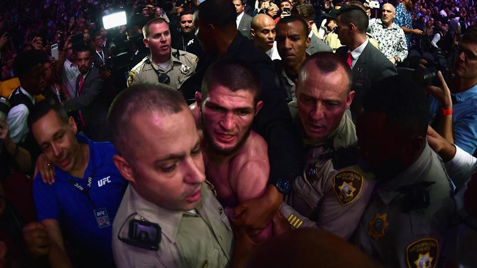 Khabib Nurmagomedov was escorted out of UFC 229 by police after beating Conor McGregor. Pic: Getty