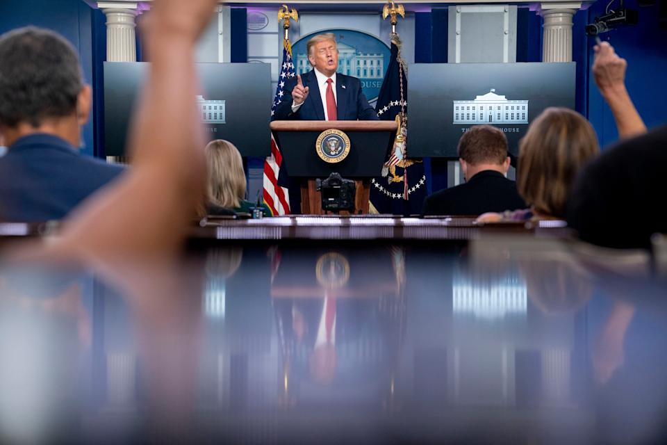 President Donald Trump speaks at a news conference in the James Brady Press Briefing Room at the White House, Monday, Aug. 10, 2020, in Washington. Trump briefly left because of a security incident outside the fence of the White House.
