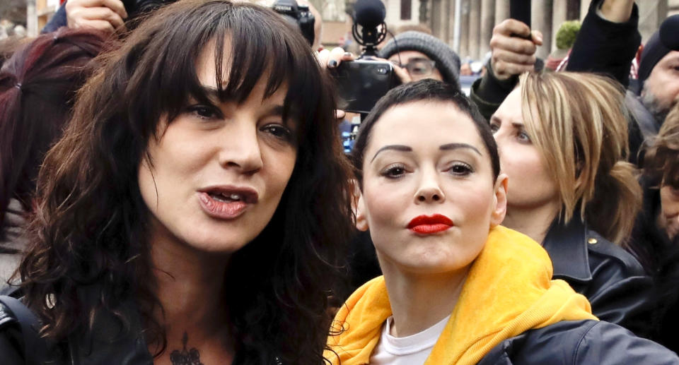 Actresses Asia Argento, left, and Rose McGowan participate in a demonstration to mark International Women's Day in Rome, March 8, 2018. (Photo: AP Photo/Alessandra Tarantino)