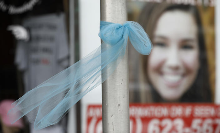 A ribbon for missing University of Iowa student Mollie Tibbetts hangs on a light post, Tuesday, Aug. 21, 2018, in Brooklyn, Iowa. Tibbetts was reported missing from her hometown in the eastern Iowa city of Brooklyn in July 2018. (AP Photo/Charlie Neibergall)