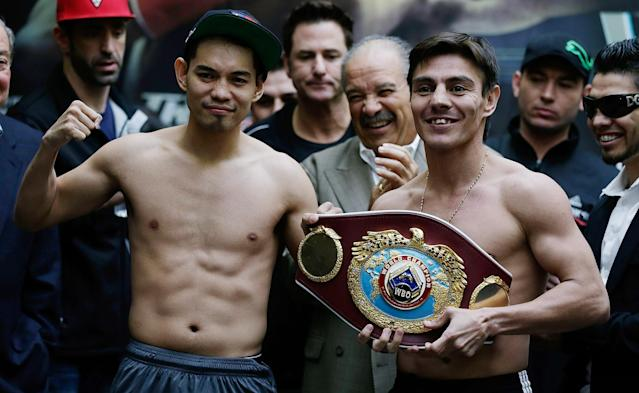 HOUSTON, TX - DECEMBER 14: Nonito Donaire of the Philippines (L) and Jorge Arce of Mexico (R) pose on stage after their official weigh-in at the PlazAmericas Mall on December 14, 2012 in Houston, Texas. (Photo by Scott Halleran/Getty Images)