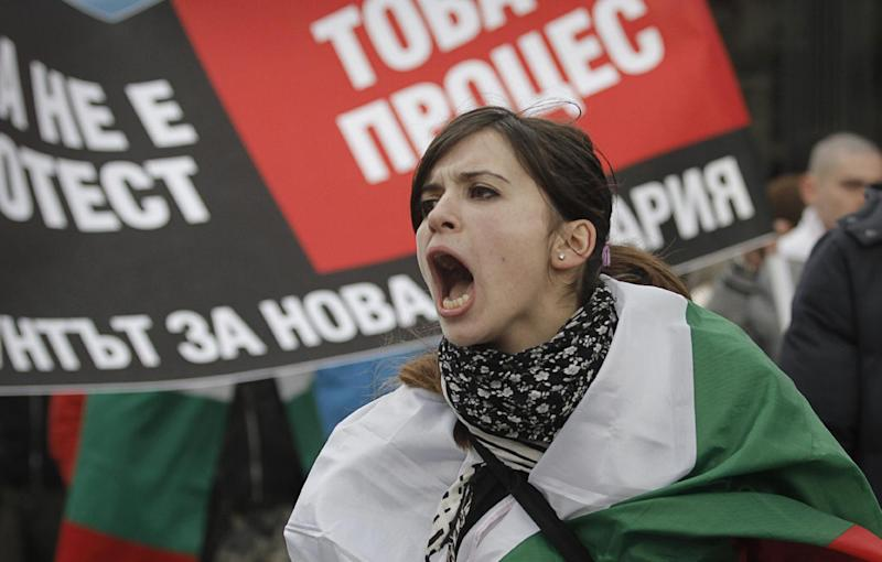 FILE - A Bulgarian woman shout slogans during a protest against higher electricity and heating bills, in Sofia,  in this Sunday, Feb. 17, 2013 file photo. A quarter century after the fall of communism in Bulgaria, dreams of prosperity have turned awfully sour in the Balkan country, which is the poorest in the European Union. Four people in less than a month have set themselves on fire in protest.  (AP Photo/Valentina Petrova, File)
