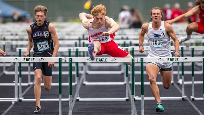 Boise High's Anders Covey eyes the finish line as he clears the final hurdle and wins the 5A boys 110-meter hurdles Saturday, May 22, 2021, at Eagle High School.