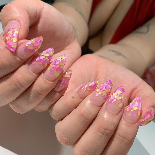 """<p>This layered heart decal manicure looks best on long, pointy nails. </p><p><a href=""""https://www.instagram.com/p/BxYP-VPgO8X/"""" rel=""""nofollow noopener"""" target=""""_blank"""" data-ylk=""""slk:See the original post on Instagram"""" class=""""link rapid-noclick-resp"""">See the original post on Instagram</a></p>"""