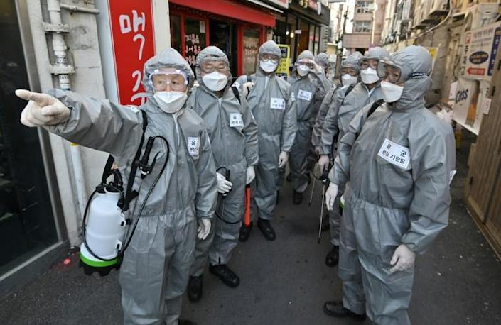 Coronavirus infections are now rising faster abroad with South Korea one of the hotspots (AFP Photo/Jung Yeon-je)