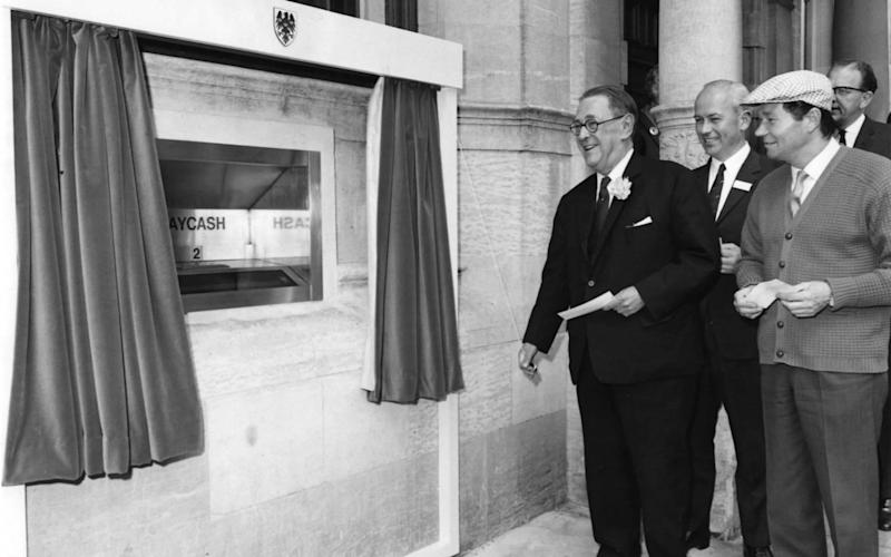 Britain's first cash machine opened in 1967, but use of cash is now declining - Fox Photos