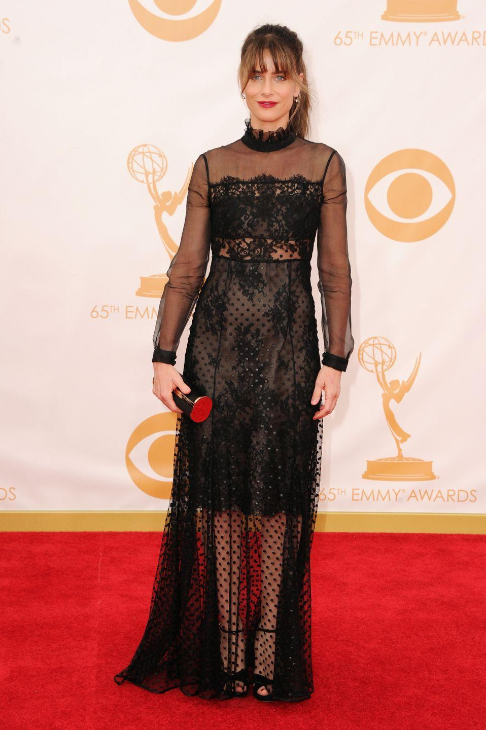 <p>Peet proved you can be covered up and still sexy thanks to hints of skin through her sheer lace dress. </p>
