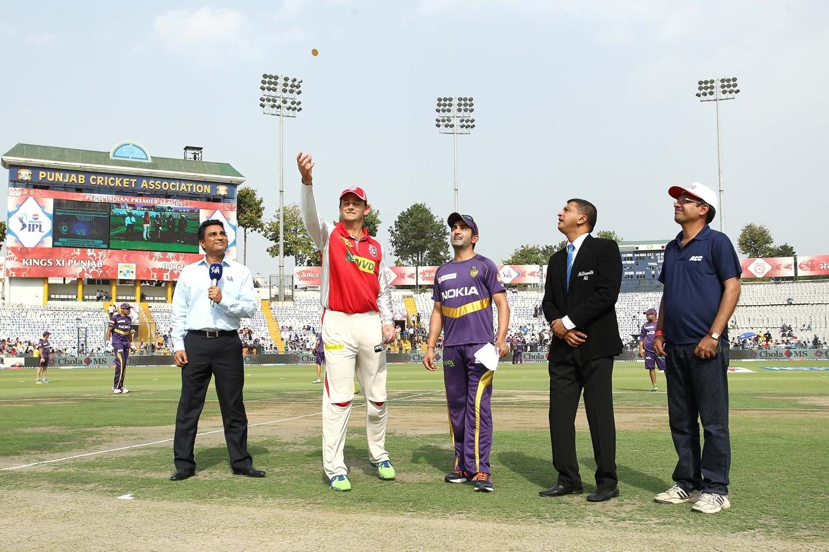 Kings XI Punjab captain Adam Gilchrist tosses the coin as Kolkata Knight Riders captain Gautam Gambhir calls during match 20 of the Pepsi Indian Premier League between The Kings XI Punjab and the Kolkata Knight Riders held at the PCA Stadium, Mohal, India  on the 16th April 2013..Photo by Shaun Roy-IPL-SPORTZPICS  ..Use of this image is subject to the terms and conditions as outlined by the BCCI. These terms can be found by following this link:..https://ec.yimg.com/ec?url=http%3a%2f%2fwww.sportzpics.co.za%2fimage%2fI0000SoRagM2cIEc&t=1498418528&sig=MaTIrLlcQBfkEzZt67kJ1g--~C