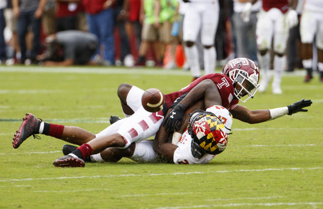 Temple cornerback Christian Braswell, top, breaks up a pass intended for Maryland wide receiver Darryl Jones (21) during the first half of an NCAA college football, Saturday, Sept. 14, 2019, in Philadelphia. (AP Photo/Chris Szagola)
