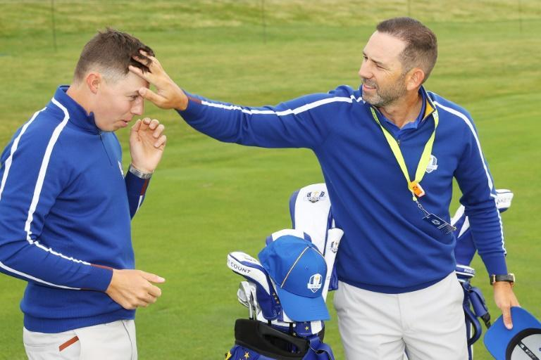 Spain's Sergio Garcia, right, adjusts the hair of England's Matthew Fitzpatrick as the Europe teammates prepare for a Ryder Cup team photo on Tuesday ahead of Friday's start of the biennial team golf matches at Whistling Straits (AFP/Andrew Redington)