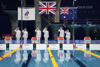 The flag raising ceremony for the men's 4x200-meters swimming relay is performed at the 2020 Summer Olympics, Wednesday, July 28, 2021, in Tokyo, Japan. (AP Photo/Matthias Schrader)