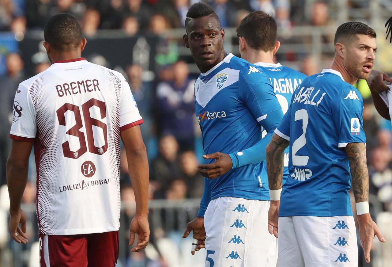 FILE - In this Saturday, Nov. 9, 2019 filer, Brescia's Mario Balotelli, center, walks on the pitch during the Serie A soccer match between Brescia and Torino at the Mario Rigamonti Stadium in Brescia, Italy. Three leaders of the extreme-right Forza Nuova political party have been stopped by police for putting up a racist banner aimed at Brescia striker Mario Balotelli. The banner, which read Mario youre right, youre an African, was posted on a fence outside Juventus Allianz Stadium in Turin last month. The words Mario and African were written in red with the other words in black. The banner also featured a logo for the neo-fascist Forza Nuova party. (Filippo Venezia/ANSA via AP, File)