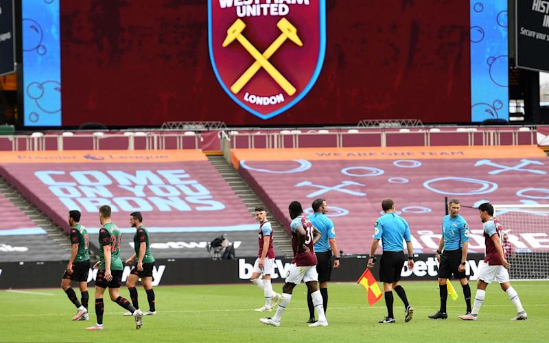 Players walk from the pitch at half time during the Premier League match between West Ham United and Aston Villa at London Stadium on July 26, 2020 in London, England. Football Stadiums around Europe remain empty due to the Coronavirus Pandemic as Government social distancing laws prohibit fans inside venues resulting in all fixtures being played behind closed doors - Getty Images Europe