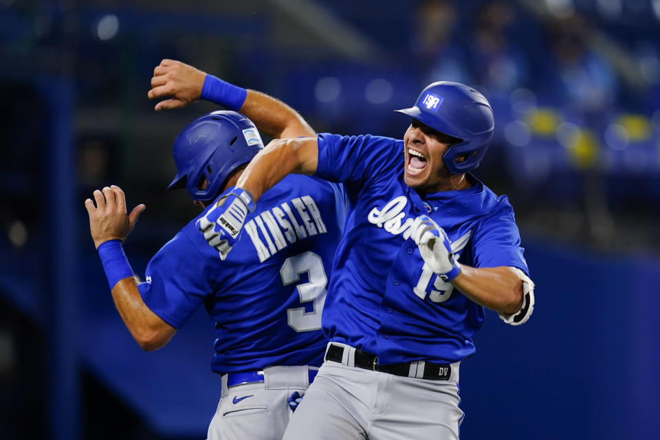 Israel's Danny Valencia, right, celebrate with Ian Kinsler after hitting a two run home run during the eight inning of a baseball game against the Dominican Republicat at the 2020 Summer Olympics, Tuesday, Aug. 3, 2021, in Yokohama, Japan. (AP Photo/Matt Slocum)