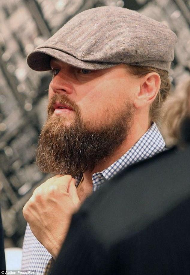 <p>Leo's short-lived lumberjack look featuring a long beard and man bun (not attached by sideburns) is not his best. (Photo: Action Press/REX)</p>