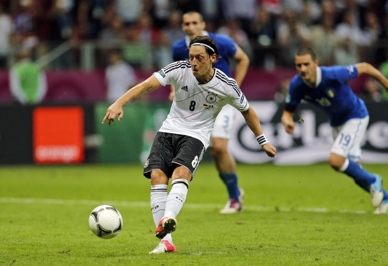 Germany's Mesut Oezil scores from a penalty kick during the Euro 2012 soccer championship semifinal match between Germany and Italy in Warsaw, Poland, Thursday, June 28, 2012. (AP Photo/Matthias Schrader)