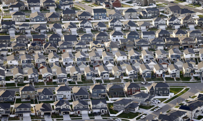 FILE - Rows of homes, are shown in suburban Salt Lake City, on April 13, 2019. Utah is one of two Western states known for rugged landscapes and wide-open spaces that are bucking the trend of sluggish U.S. population growth. The boom there and in Idaho are accompanied by healthy economic expansion, but also concern about strain on infrastructure and soaring housing prices. (AP Photo/Rick Bowmer, File)