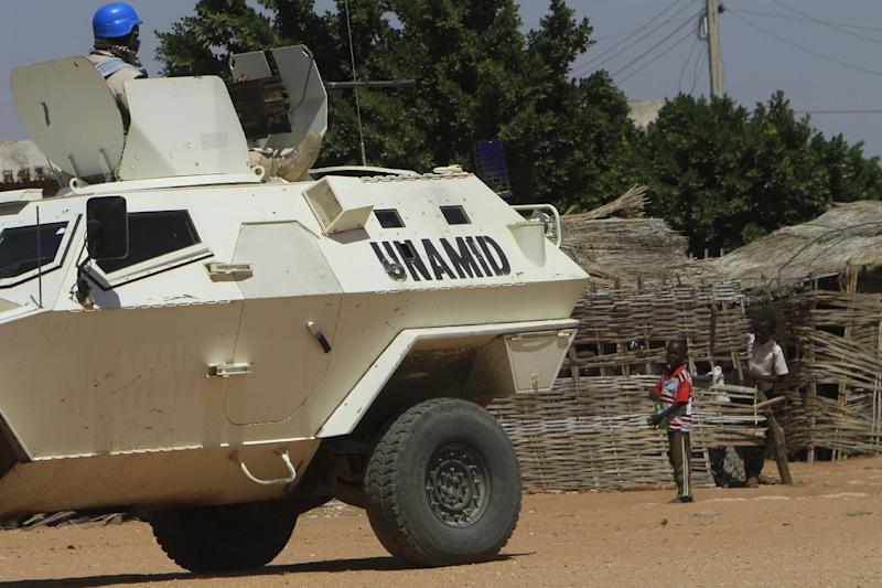 A UN-African Union mission to Darfur vehicle patrols a street in Nyala, in Sudan's Darfur, on November 5, 2014