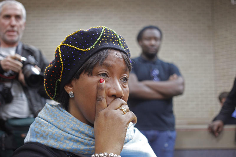 Makaziwe Mandela, daughter of former South African president Nelson Mandela, sits in court in Mthatha, South Africa, Tuesday, July 2, 2013. As Nelson Mandela remains hospitalized in critical condition, the 94-year-old's oldest daughter, Makaziwe, and 15 other family members have pressed a court application to get Mandela's grandson, Mandla Mandela, to return the bodies of three of Mandela's children to their original graves in the eastern rural village of Qunu. (AP Photo/Schalk van Zuydam)