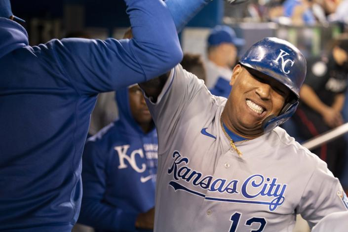 Kansas City Royals' Salvador Perez (13) celebrates his solo home run against the Toronto Blue Jays during sixth-inning baseball game action in Toronto, Friday, July 30, 2021. (Peter Power/The Canadian Press via AP)