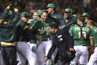Oakland Athletics' Matt Olson (28) celebrates after hitting the game winning home run off Houston Astros' Tony Sipp in the tenth inning of a baseball game Friday, Aug. 17, 2018, in Oakland, Calif. (AP Photo/Ben Margot)