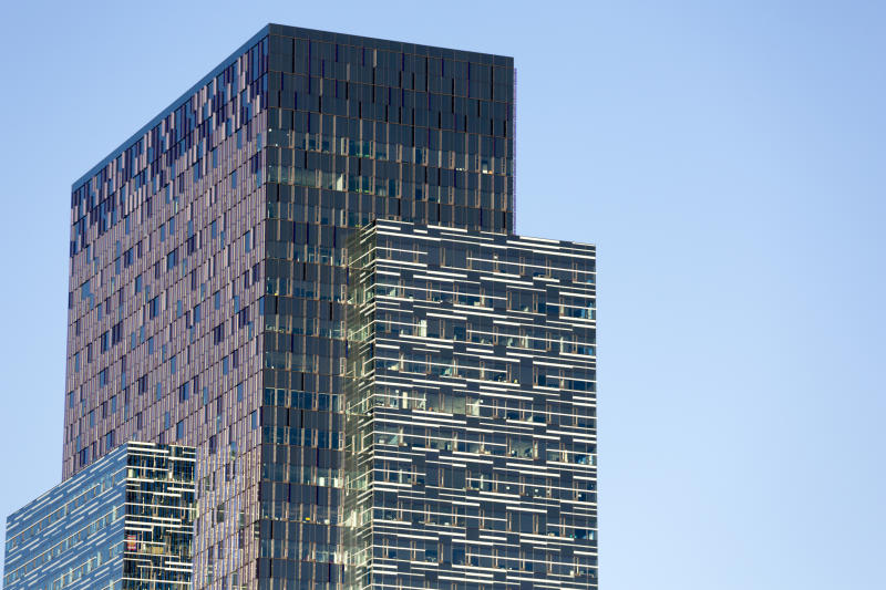 The worldwide headquarters of Amazon, or Amazon.com, located in downtown Seattle Washington, feature dual towers with multiple architectural features. Dividers provide for a colorful, abstract visual display.