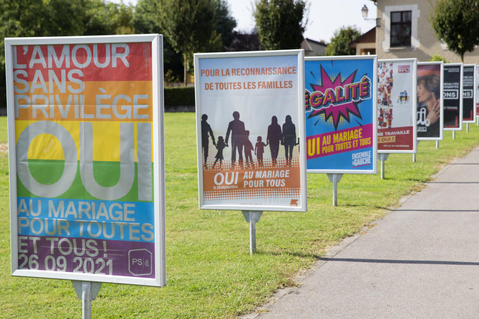 Posters of political parties and associations showing their slogans in Perly near Geneva, Saturday Sept. 25, 2021. Voters in Switzerland will decide Sunday whether to allow same-sex marriages in the rich Alpine country, one of the few in Western Europe where gay and lesbian couples do not already have the right to wed. Opponents have argued that replacing civil partnerships with full marriage rights somehow would undermine families based on a union between one man and one woman. (Salvatore Di Nolfi/Keystone via AP)