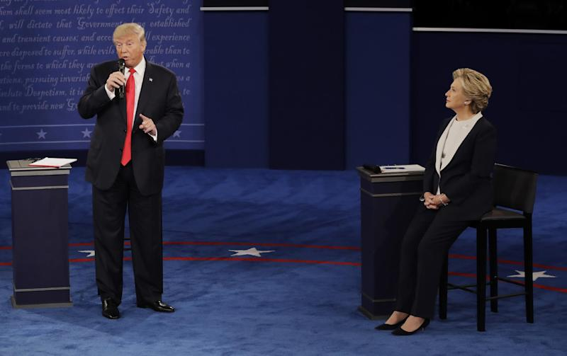 Democratic presidential nominee Hillary Clinton listens to Republican presidential nominee Donald Trump during the second presidential debate at Washington University in St. Louis, Sunday, Oct. 9, 2016. (AP Photo/Patrick Semansky)