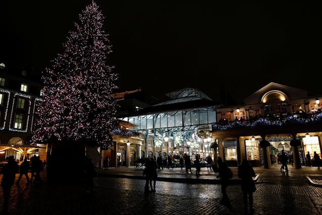 <p>Shoppers walk near a Christmas Tree at Covent Garden in London, Britain, November 30, 2017. REUTERS/Darrin Zammit Lupi </p>