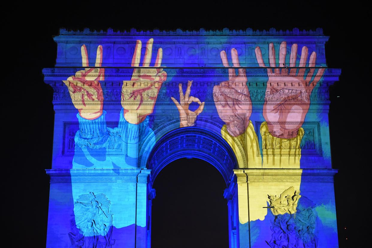 Images are projected on the Arc de Triomphe monument during a laser and 3D video mapping show as part of New Year's celebrations in Paris on December 31, 2017. (Photo: GUILLAUME SOUVANT via Getty Images)
