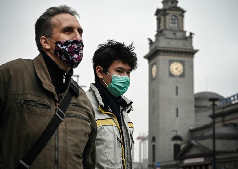 Pedestrians wear face masks as they walk in central Moscow on November 20, 2020
