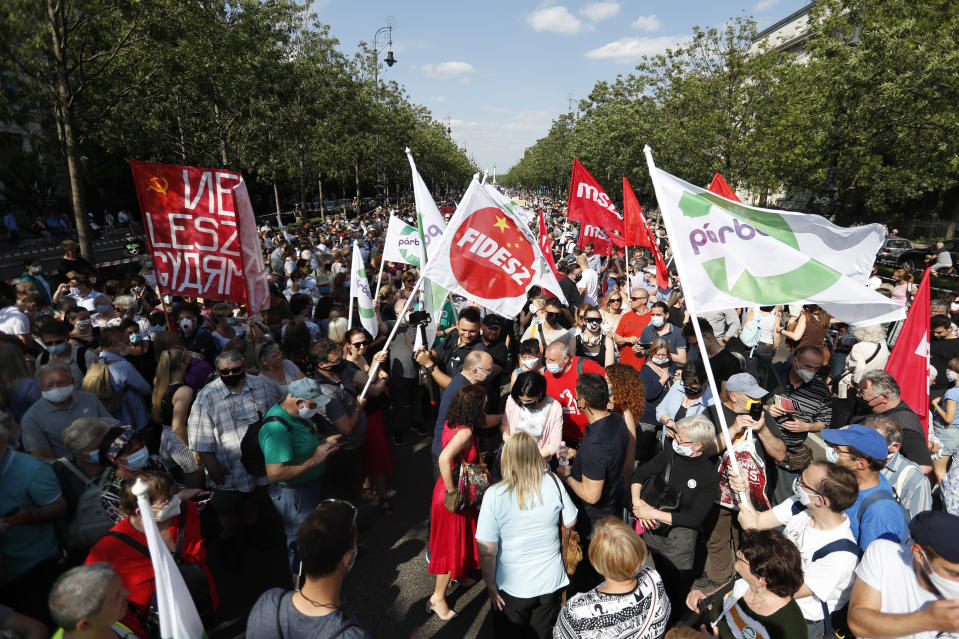 Protesters gather in Budapest, Hungary, Saturday, June 5, 2021. Thousands of people gathered opposing the Hungarian government's plan of building a campus for China's Fudan University in Budapest. (AP Photo/Laszlo Balogh)