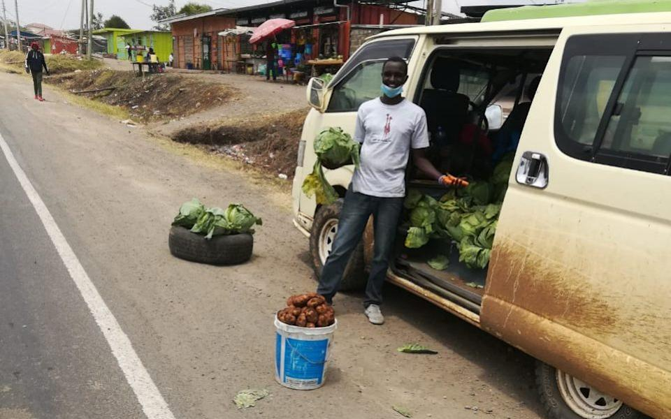 Douglas Kiktru selling vegetables from his van - Douglas Kikutu