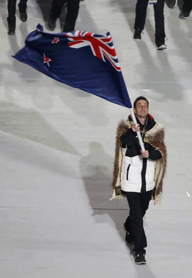 New Zealand's flag-bearer Shane Dobbin leads his country's contingent during the opening ceremony of the 2014 Sochi Winter Olympics, February 7, 2014. REUTERS/Lucy Nicholson (RUSSIA - Tags: OLYMPICS SPORT)