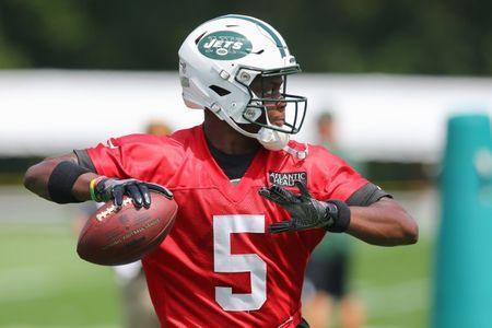 Jul 28, 2018; Florham Park, NJ, USA; New York Jets quarterback Teddy Bridgewater (5) throws the ball during training camp at Atlantic Health Jets Training Center. Mandatory Credit: Vincent Carchietta-USA TODAY Sports