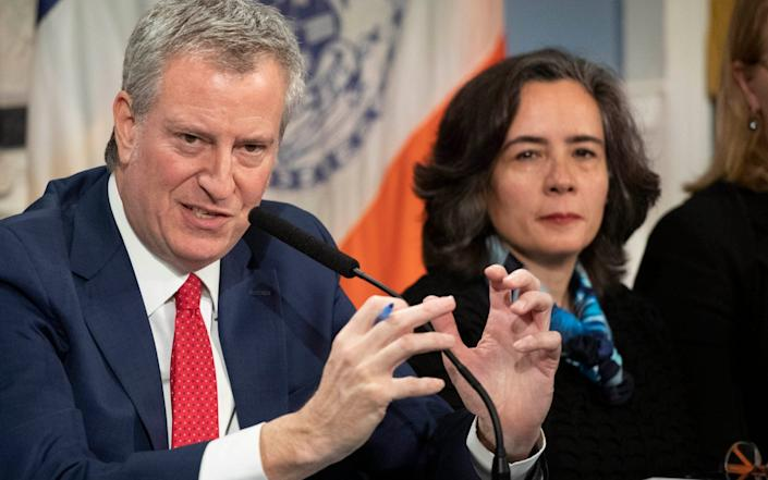 In this Wednesday, Feb. 26, 2020, file photo, Mayor Bill de Blasio, left, is shown with Dr. Oxiris Barbot, commissioner of the New York City Department of Health and Mental Hygiene. - Mark Lennihan/AP