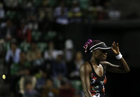Williams of the U.S. reacts as she loses a point against Kvitova of the Czech Republic during their semi-final of the Pan Pacific Open tennis tournament in Tokyo