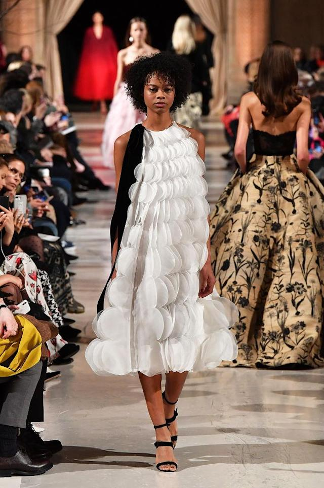 <p>A ruffled, tiered white dress at the Oscar de la Renta FW18 show. (Photo: Getty) </p>