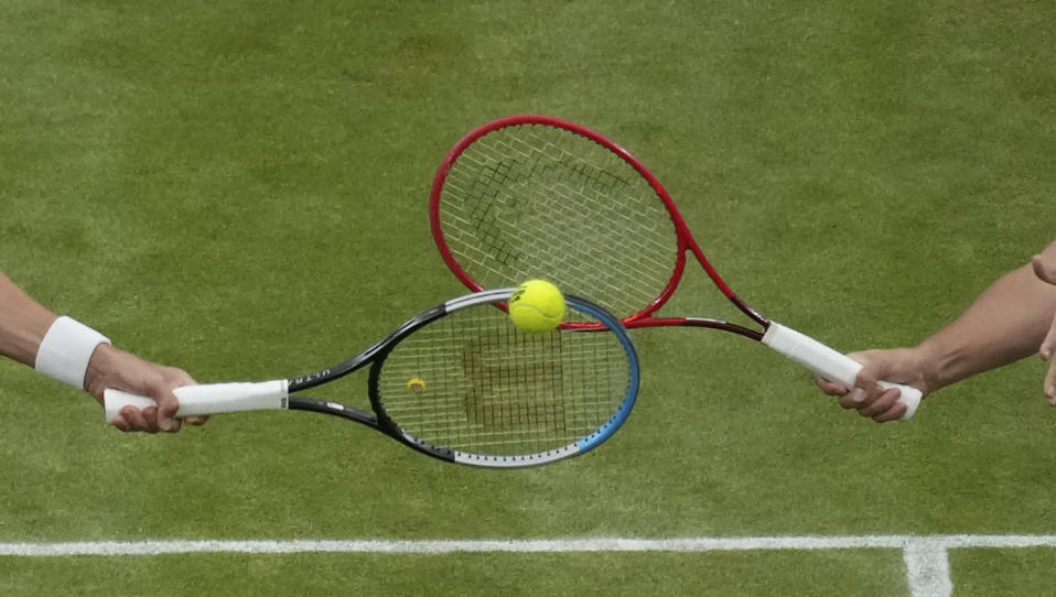 Croatia's Nikola Mektic, right, and Mate Pavic plays against Spain's Marcel Granollers and Argentina's Horacio Zeballos during the men's doubles final match on day twelve of the Wimbledon Tennis Championships in London, Saturday, July 10, 2021. (AP Photo/Alberto Pezzali)