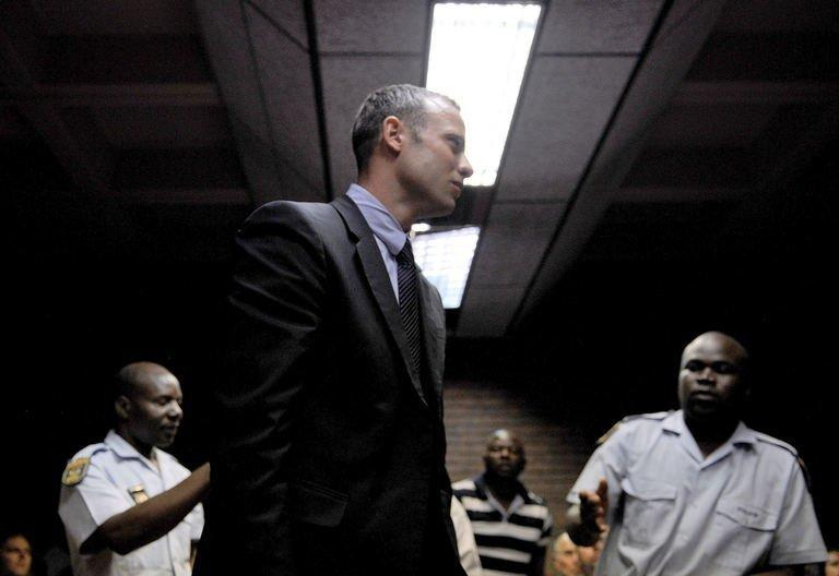 Oscar Pistorius leaves a Pretoria courtroom on February 15, 2013 after his hearing on charges of murdering his girlfriend