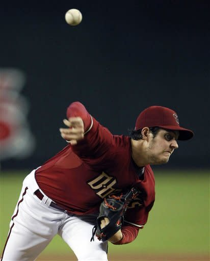 Arizona Diamondbacks pitcher Trevor Bauer throws against the Los Angeles Dodgers against the Arizona Diamondbacks in the first inning during a baseball game on Sunday, July 8, 2012, in Phoenix. (AP Photo/Rick Scuteri)