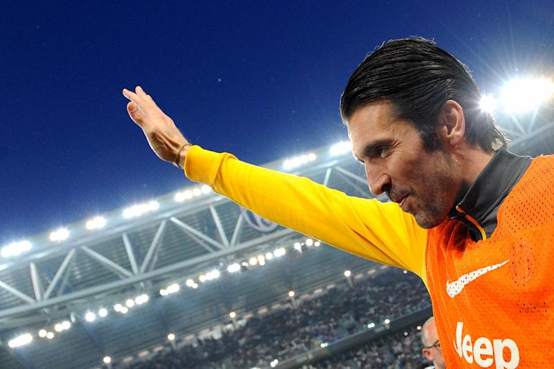 Juventus goalkeeper Gianluigi Buffon waves to supporters prior tot the start of a Serie A soccer match between Juventus and Atalanta at the Juventus stadium, in Turin, Italy, Monday, May 5, 2014