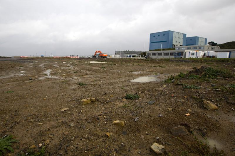 Hinkley Point A nuclear power station (pictured, R) next to development land where Hinkley Point C's reactors will be built in Somerset, southwest England on October 21, 2013 (AFP Photo/Justin Tallis)