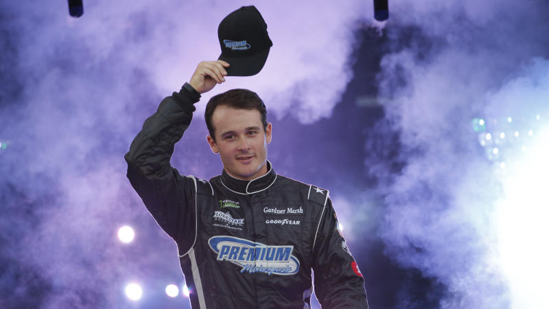 Quin Houff tips his hat during driver introductions for the NASCAR Monster Energy Cup series auto race at Richmond Raceway in Richmond, Va., Saturday, Sept. 21, 2019. (AP Photo/Steve Helber)