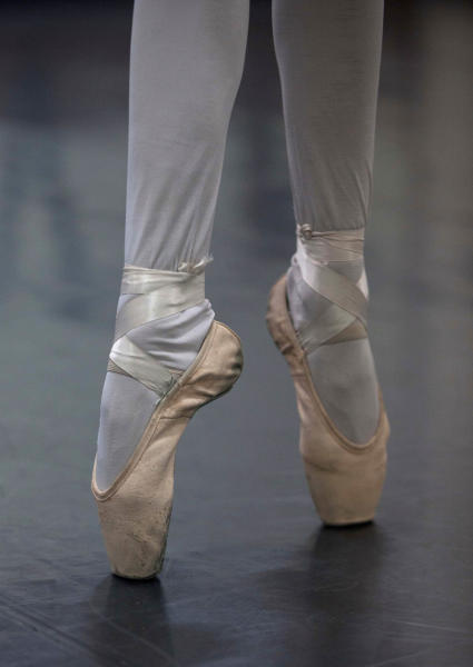 In this Aug. 28, 2012 photo, a dancer stands on her toes as she trains for a ballet competition at the National Superior Ballet School in Lima, Peru. Nearly 100 girls and boys from Colombia, Venezuela, Chile, France and Peru are submitting themselves to a week-long competition hoping to win medals from Peru's national ballet school _ and perhaps a grant to study in Miami. (AP Photo/Martin Mejia)
