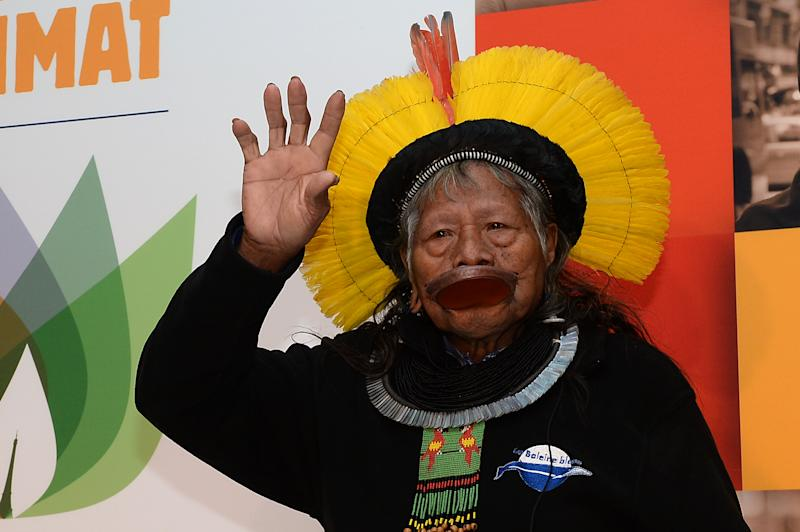 President of the Raoni Institute and Chief of the Kayapo tribe, Cacique Raoni Metuktire arrives at a press conference on December 10, 2015 in Paris on the sidelines of the COP21 United Nations Climate Change Conference at Le Bourget on the outskirts of Paris. / AFP / Miguel MEDINA (Photo credit should read MIGUEL MEDINA/AFP/Getty Images)