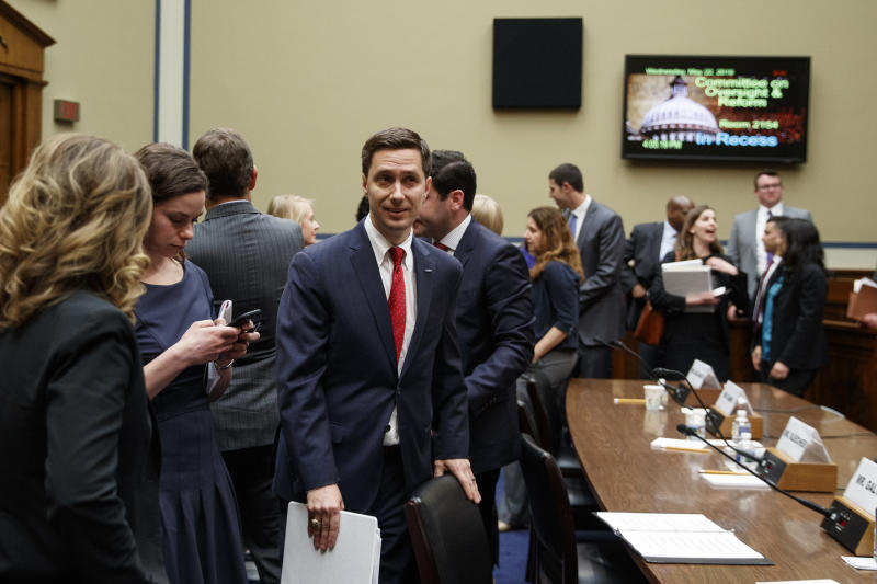 """Twitter Public Policy Manager Kevin Kane walks from the hearing room during a break in testimony on Capitol Hill in Washington, Wednesday, May 22, 2019, during the House Oversight and Reform National Security subcommittee hearing on """"Securing U.S. Election Infrastructure and Protecting Political Discourse."""" (AP Photo/Carolyn Kaster)"""