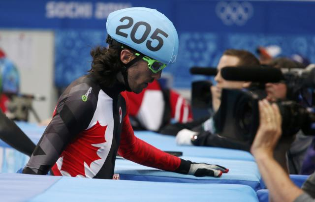 Canada's Charles Hamelin leaves the rink after crashing out during the men's 1,000 metres short track speed skating quarter-finals race at the Iceberg Skating Palace at the Sochi 2014 Winter Olympic Games