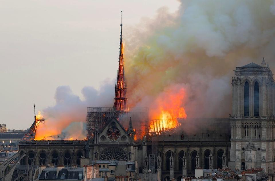 A massive fire on Monday ravaged the 850-year-old Gothic building, destroying much of its roof and causing its spire to collapse. (Getty)